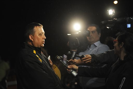 St. Lawrence County Sheriff Kevin M. Wells addresses the media Thursday night, Aug. 14, 2014 in Heuvelton after Fannie Miller, 12, and her sister Delila Miller, 6, were returned home safely after being abducted the night before. (AP Photo)