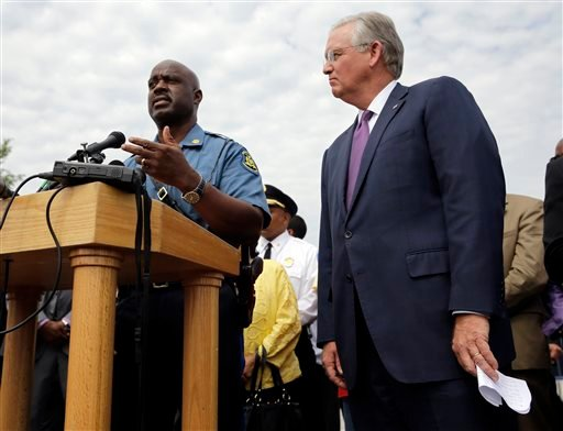 Capt. Ron Johnson of the Missouri Highway Patrol, left, answers questions along side Missouri Gov. Jay Nixon during a news conference Friday, Aug. 15, 2014, in Ferguson, Mo. (AP)