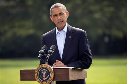 In this Aug. 9, 2014, photo, President Barack Obama speaks on the South Lawn of the White House in Washington, about the ongoing situation in Iraq.