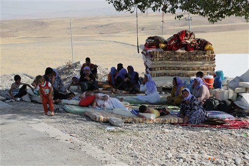 Displaced Iraqis from the Yazidi community settle at the Qandil mountains near the Turkish border outside Zakho, 300 miles (475 kilometers) northwest of Baghdad, Iraq, Saturday, Aug. 16, 2014.