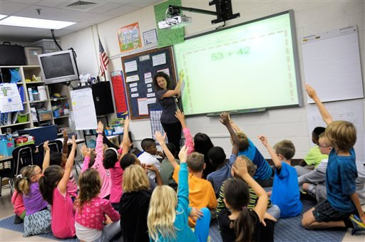 In this Oct. 1, 2013, file photo, third grade teacher Melissa Grieshober teaches a math lesson at Silver Lake Elementary School in Middletown, Del.