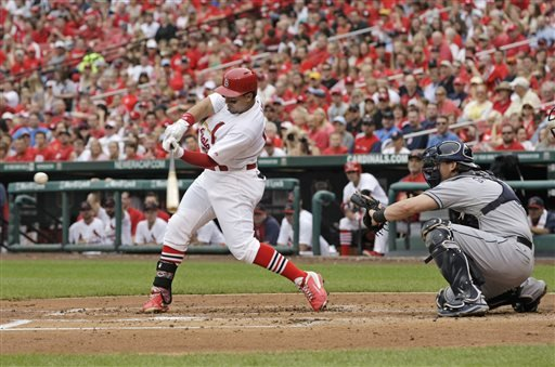 St. Louis Cardinals' Jon Jay (19) connects for a two-RBI single as San Diego Padres catcher Yasmani Grandal watches in the first inning of a baseball game, Sunday, Aug. 17, 2014, in St. Louis. (AP Photo/Tom Gannam)