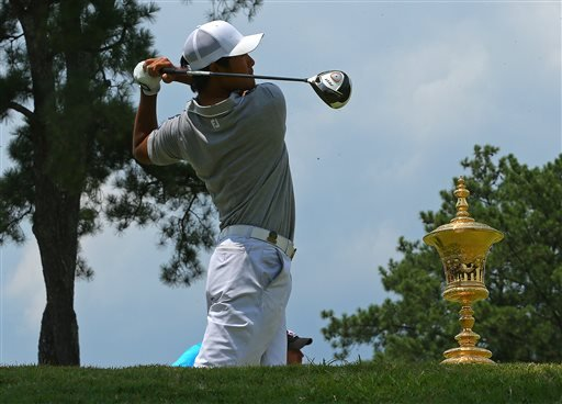 The trophy sits on the tee box as Gunn Yang tees off on the first hole during the 2014 U.S. Amateur Championship at Atlanta Athletic Club on Sunday, Aug. 17, 2014, in Johns Creek, Ga.