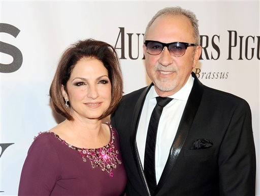 In this June 8, 2014, file photo, Gloria Estefan, left, and Emilio Estefan pose for photos at the 68th annual Tony Awards at Radio City Music Hall in New York.