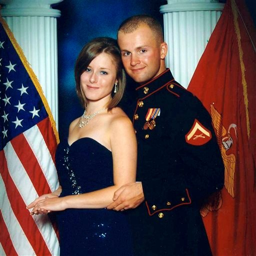 FILE - This undated file photo provided by the San Bernardino County, Calif., Sheriff's Department shows Erin Corwin, left, with her husband, Jonathan Wayne Corwin, a corporal in the U.S. Marine Corps. (AP)