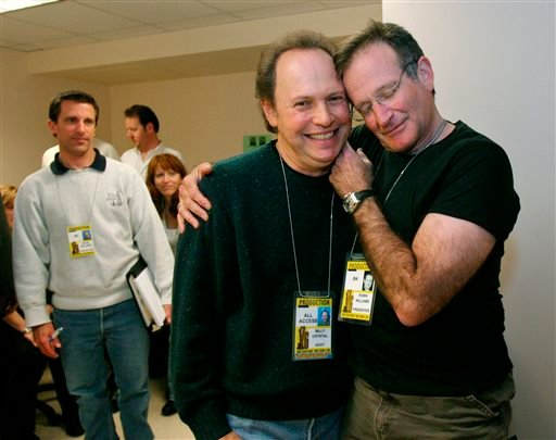 FILE - This Feb. 28, 2004 file photo shows Oscar host Billy Crystal, center, and presenter Robin Williams, right, joking around after a writers' meeting for the 76th annual Academy Awards in Los Angeles. (AP)