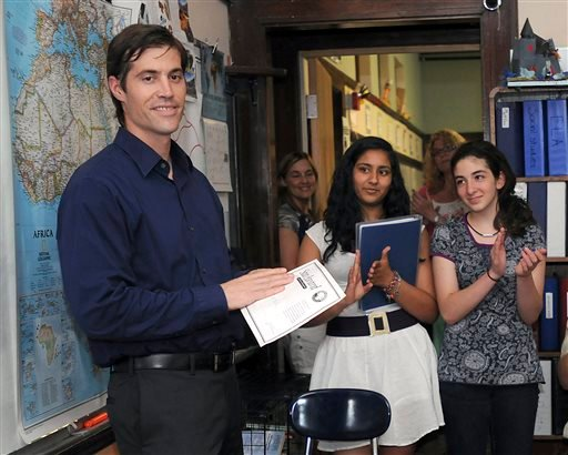 In this June 17, 2011 photo, journalist James Foley receives applause from students at the Christa McAuliffe Regional Charter Public School in Framingham, Mass. (AP Photo/MetroWest Daily News, Ken McGagh)