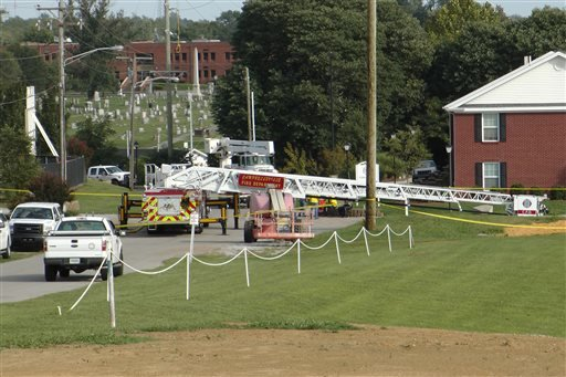 A Campbellsville Fire Department truck with the ladder extended remained at the scene where two firefighters were injured during an ice bucket challenge during a fundraiser for ALS on Thursday, Aug. 21, 2014, in Campbellsville, Ky.
