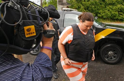 St. Lawrence County Sheriff's deputies escort Nicole Vaisey, 25, into Fowler Town Court for her preliminary hearing, Thursday, Aug 21, 2014, in Fowler, N.Y.