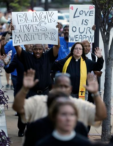 Protesters march to the Buzz Westfall Justice Center Wednesday, Aug. 20, 2014, in Clayton, Mo.