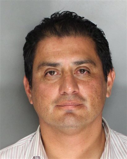 This photo provided by the Sacramento County Sheriff's Department shows the booking photo of state Sen. Ben Hueso, D-San Diego, who was arrested on charges of drunken driving in Sacramento, Calif.