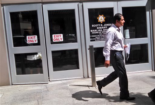 Democratic state Sen. Ben Hueso walks out of the Sacramento County Jail in Sacramento, Calif., Friday, Aug. 22, 2014.
