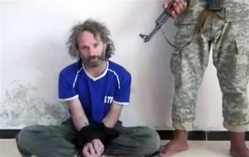 In this image made from undated video obtained by The Associated Press, which has been authenticated based on its contents and other AP reporting, a man believed to be Peter Theo Curtis, a U.S. citizen held hostage by an al-Qaida linked group in Syria..