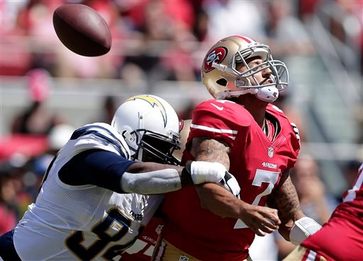 San Francisco 49ers quarterback Colin Kaepernick (7) loses the ball as he is hit by San Diego Chargers defensive end Corey Liuget during the first quarter of an NFL preseason football game in Santa Clara, Calif., Sunday, Aug. 24, 2014.