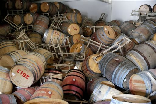 Barrels filled with Cabernet Sauvignon are toppled on one another following an earthquake at the B.R. Cohn Winery barrel storage facility Sunday, Aug. 24, 2014, in Napa, Calif.