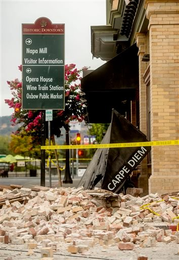 An awning for Carpe Diem wine bar sits among rubble in Napa, Calif., following an earthquake Sunday, Aug. 24, 2014.