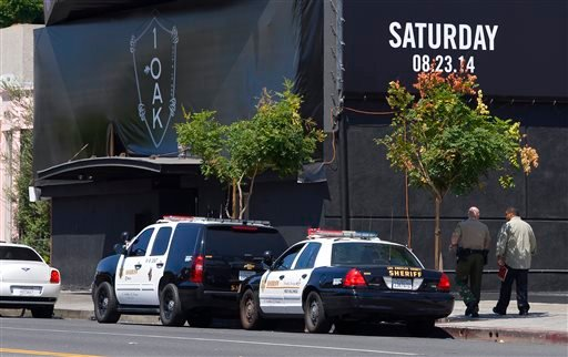 Sheriffs vehicles are seen outside the 1OAK club, Sunday, Aug. 24, 2014, in West Hollywood, Calif.