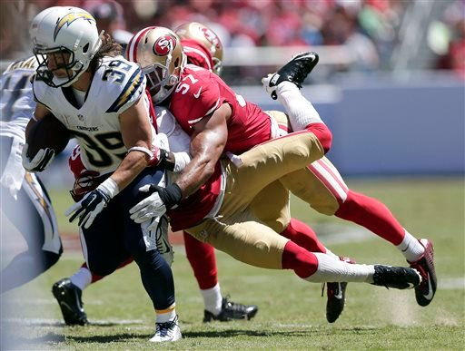 San Diego Chargers running back Danny Woodhead (39) runs against San Francisco 49ers defensive back Chris Culliver, center, and linebacker Michael Wilhoite (57).