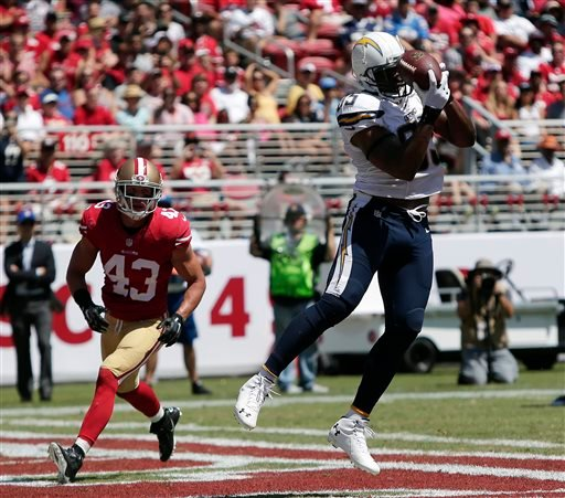 San Diego Chargers tight end Antonio Gates, right, catches a 10-yard touchdown pass in front of San Francisco 49ers strong safety Craig Dahl (43).