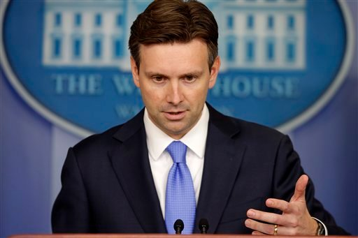 White House press secretary Josh Earnest gestures during the daily press briefing at the White House in Washington, Monday, Aug. 25, 2014, where he took questions on ISIS, Iraq, and Syria. He also received congratulations for his newborn baby.