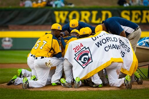 Aug. 23, 2014 file photo: The Chicago team gathers in the field after winning the U.S. final 7-5 over Las Vegas in the Little League World Series in South Williamsport, Pa. (AP Photo/PennLive.com, Elizabeth Frantz, File)