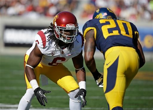 FILE - In this Nov. 9, 2013, file photo, Southern California cornerback Josh Shaw, left, lines up against California defensive back Isaac Lapite during the first quarter of an NCAA college football game in Berkeley, Calif. (AP)