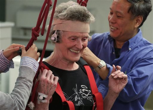 This July 28, 2014 photo shows Mary Kaye, 81, smiling after successfully demonstrating a treadmill balance session at University of Illinois-Chicago. (AP Photo/M. Spencer Green)