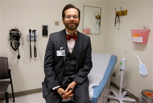 Dr. Robert Palinkas, director of the McKinley Health Center at the University of Illinois, poses in an exam room in Urbana, Ill., Thursday, Aug. 21, 2014.