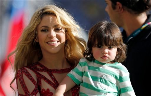 In this July 13, 2014 file photo, singer Shakira carries her son Milan after she performed during the closing ceremony prior to the World Cup final soccer match between Germany and Argentina at the Maracana Stadium in Rio de Janeiro, Brazil.