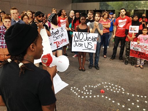 In this Aug. 5, 2014 file photo, members of the Ohio Student Association gather outside Ohio Attorney General Mike DeWine's office in Columbus, Ohio, to call for the release of in-store video in the fatal police shooting.