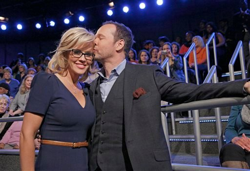 """In this April 16, 2014, file photo released by ABC shows co-host Jenny McCarthy with her fiance Donnie Wahlberg after she announced her engagement on the daytime series """"The View,"""" in New York."""