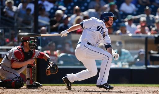 San Diego Padres' Corey Spangenberg drives his first major league hit to right field and drives in his first two runs in the fifth inning of a baseball game against the Arizona Diamondbacks, Monday, Sept. 1, 2014, in San Diego. (AP Photo/Lenny Ignelzi)