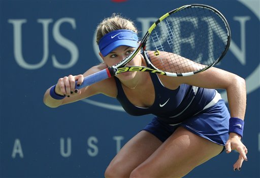 Eugenie Bouchard, of Canada, returns a shot against Ekaterina Makarova, of Russia, during the fourth round of the 2014 U.S. Open tennis tournament, Monday, Sept. 1, 2014, in New York. (AP Photo/John Minchillo)