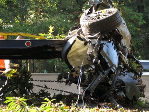 This Oct. 8, 2012 file photo shows the wrecked Subaru Impreza in which four people died as it is loaded onto a flatbed truck on the Southern State Parkway in West Hempstead, N.Y., after and early-morning accident.