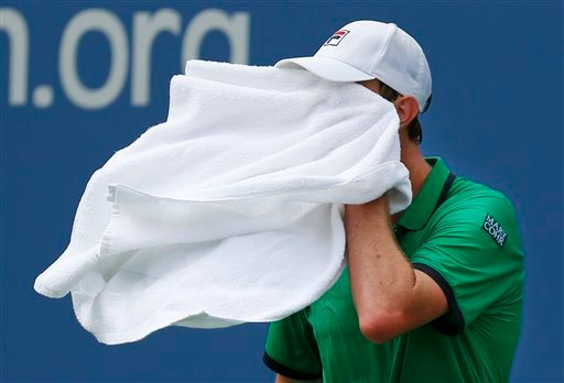 Sam Querrey, of the United States, wipes sweat from his face between serves against Novak Djokovic, of Serbia, during the third round of the 2014 U.S. Open tennis tournament, Saturday, Aug. 30, 2014, in New York. (AP Photo/Matt Rourke)