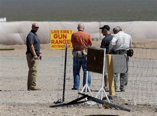 FILE - This Aug. 27, 2014 file photo shows people seen at the Last Stop outdoor shooting range in White Hills, Ariz. (AP)