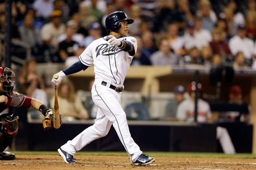 San Diego Padres shortstop Alexi Amarista hits an RBI single while batting against the Arizona Diamondbacks during the fifth inning of a baseball game Tuesday, Sept. 2, 2014, in San Diego. (AP Photo/Gregory Bull)