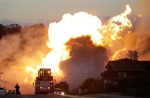 File - In this Sept. 9, 2010 file photo, a massive fire roars through a mostly residential neighborhood in San Bruno, Calif. (AP Photo/Paul Sakuma, File)