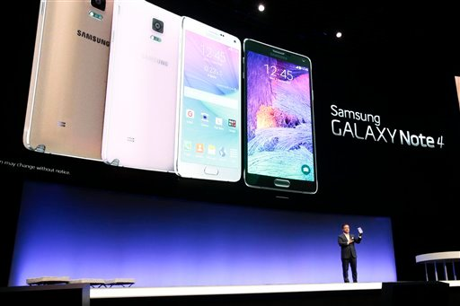 DJ Lee, Executive Vice President of Samsung, presents a Samsung Galaxy Note 4 during his keynote at an unpacked event of Samsung ahead oh the consumer electronic fair IFA in Berlin, Wednesday, Sept. 3, 2014. (AP Photo/Markus Schreiber)