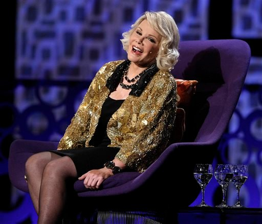 "In this Sunday, July 26, 2009 file photo, Joan Rivers greets the audience at the ""Comedy Central Roast of Joan Rivers"" in Los Angeles."