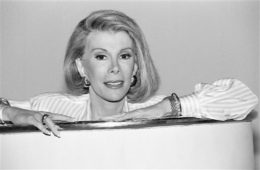 "In this Aug. 15, 1989 file photo ,Joan Rivers announces that she is starting a new syndicated talk show, ""The Joan Rivers Show,"" in Los Angeles."
