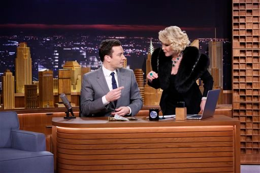 "In this Monday, Feb. 17, 2014 photo provided by NBC, Joan Rivers appears with Jimmy Fallon during his debut on ""The Tonight Show"" in New York."