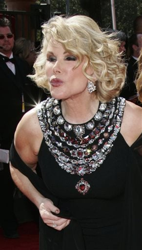 In this Sept. 18, 2005 file photo, comedian Joan Rivers blows kisses on arrival at the Primetime Emmy Awards in Los Angeles.