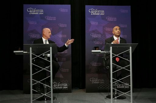 Gov. Jerry Brown, left, gestures as Republican challenger Neel Kashkari speaks during a gubernatorial debate in Sacramento, Calif., Thursday, Sept. 4, 2014. Thursday's debate is likely to be the only one of the general election.