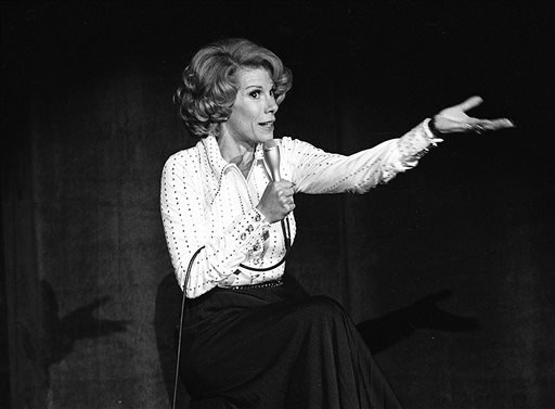 In this Aug. 13, 1975 photo released by the Las Vegas News Bureau, comedian Joan Rivers performs at the MGM in Las Vegas, Nev.