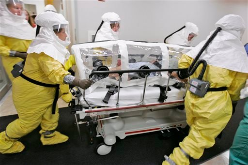 In this Oct. 28, 2006, file photo, a mock patient is wheeled in an isolation pod during a drill at the Nebraska biocontainment unit in the Nebraska Medical Center in Omaha, Neb.