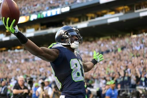 Seattle Seahawks wide receiver Ricardo Lockette celebrates after his touchdown against the Green Bay Packers in the first half of an NFL football game, Thursday, Sept. 4, 2014, in Seattle. (AP Photo/Scott Eklund)