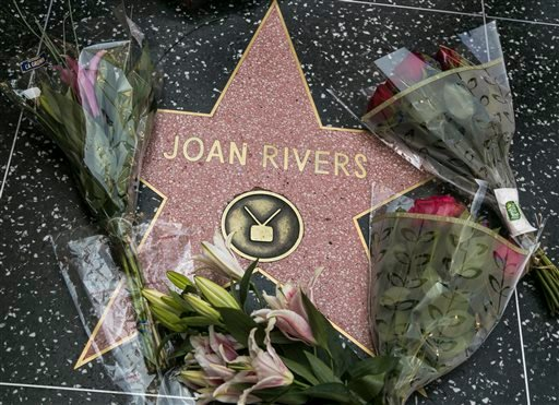 Flowers surround Joan Rivers' star on the Hollywood Walk of Fame in Los Angeles Thursday, Sept. 4, 2014.