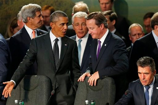 President Barack Obama speaks with British Prime Minister David Cameron as NATO leaders meet regarding Afghanistan at the NATO summit at Celtic Manor in Newport, Wales, Thursday, Sept. 4, 2014. (AP)