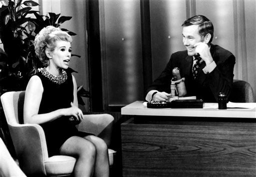 """This undated image released by NBC shows comedian Joan Rivers, left, and host Johnny Carson during """"The Tonight Show Starring Johnny Carson,"""" in Burbank, Calif."""